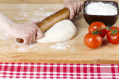 Rolling pin kneading Stock Images