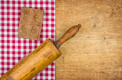 Rolling pin with mold on a wooden board Stock Photo