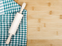 Rolling pin and napkin on wooden table Stock Photos