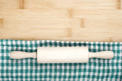 Rolling pin and napkin on wooden table Royalty Free Stock Photos