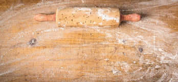 Rolling pin on old wooden background with  wheat flour, banner for website Stock Photography