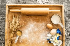Rolling pin on pastry board and food ingredients - kitchen Royalty Free Stock Images