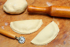 Rolling-pin with patty and pastry Royalty Free Stock Photos