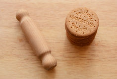 Rolling pin ready to crush biscuits Royalty Free Stock Image