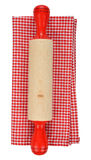 Rolling pin and red napkin. Isolated on white background Stock Photo
