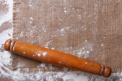 Rolling pin on sackcloth and flour horizontal Stock Photography