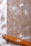 Rolling pin on sackcloth and sprinkled flour Royalty Free Stock Image