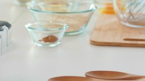 Rolling pin on the table with ingredients for homemade baking. Close up stock video