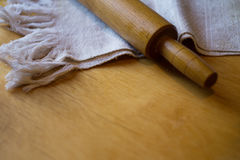 Rolling pin and towel a table Stock Images