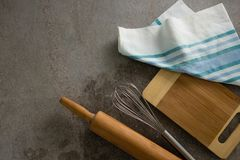 Rolling pin, whisker, chopping board and cloth on table. Close-up of rolling pin, whisker, chopping board and cloth on table stock images