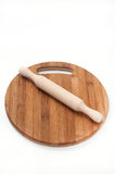 Rolling pin on wooden kitchen board on a white background Stock Photography