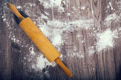 Rolling pin on a wooden table Royalty Free Stock Photo