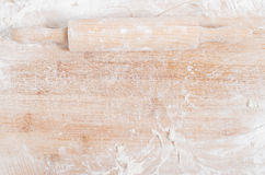 Rolling pin on a wooden tray Stock Images