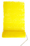 Rolling pin with yellow paint Royalty Free Stock Images