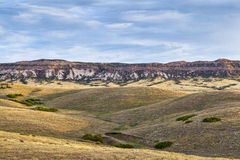 Rolling prairie and cliff Stock Images