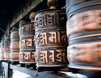 Rolling prayer wheels Stock Image