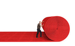Rolling red carpet Stock Photos