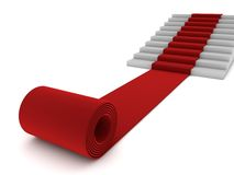 Rolling red carpet and stairs Royalty Free Stock Photos
