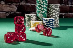 Rolling Red Dice Stock Image
