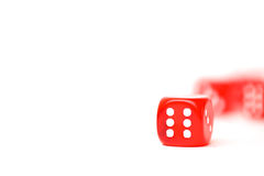 Rolling red dice isolated on white. Studio shot Royalty Free Stock Photo
