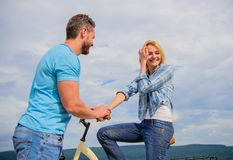 Rolling romance or bike date. asual acquaintance concept. Man with beard and shy blonde girl on first date. Woman feels. Shy in company with attractive macho royalty free stock images