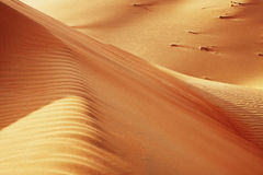 Rolling sand dunes of the Arabian desert Stock Photos