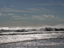 Rolling sea meets peaceful sky Royalty Free Stock Images