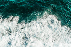 Rolling sea waves, top view of ocean covered by foam. Turquoise and green color water royalty free stock image