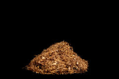 Rolling snuff. With black background and isolated royalty free stock photography