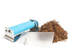 Rolling snuff. With white background and isolated stock photography