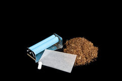 Rolling snuff. With black background and isolated stock photos