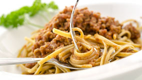 Rolling spaghetti bolognese on a fork Royalty Free Stock Images