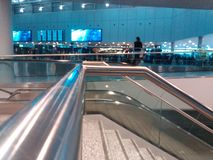 Rolling Stairs in a Hall of Zurich-Airport ZRH Royalty Free Stock Photo