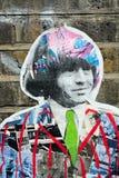 Rolling- Stone` s Collage auf einer Wand Stockbild
