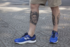 Rolling Stones fan. Anonymous Englishman, great fan of Rolling Stones rock band has tattoos of the faces of the members of the band on his legs. nnCAPTION Tattoo Stock Photos