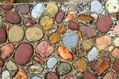 Rolling stones floor colorful pattern in Pyrenees Stock Photo