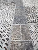 Rolling stones mosaic medieval soil floor Spain Stock Photo