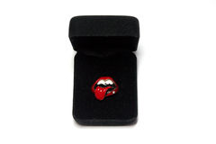 A rolling stones ring in a black box. A beautiful rolling stones ring in a black box Royalty Free Stock Photo