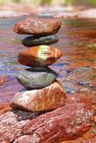 Rolling stones stacked limestone in river stock image