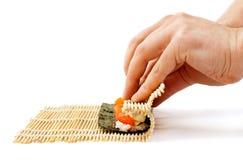 Rolling sushi maki Royalty Free Stock Image