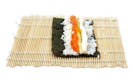 Rolling sushi maki Royalty Free Stock Photo