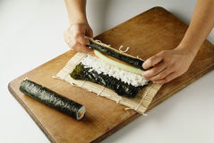 Rolling the sushis Stock Image