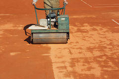 Rolling a tennis court_1 Stock Photos