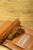 Rolling tobacco pouch Royalty Free Stock Images