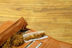 Rolling tobacco pouch Stock Images