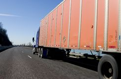 Rolling truck. On the interstate stock photography