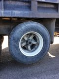 Rolling. Truck tire on the road Royalty Free Stock Photos
