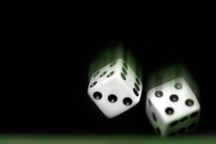 Rolling Two dices on black background Stock Images