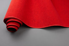 Rolling up the red carpet Royalty Free Stock Photography