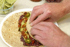 Rolling a Vegetarian Wrap Stock Image